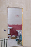 View of bathroom through doorway at construction site Stock Images