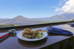 View of Batur Mount as background. People having lunch with Batur Mount as backgroud Royalty Free Stock Image
