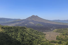 View of Batur Mount as background. People having lunch with Batur Mount as backgroud Royalty Free Stock Photography