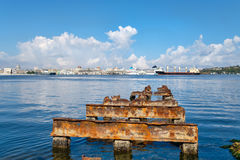 View of the Bay of Havana and The Bay of Havana and the Old Havana skyline with a rusty iron pier on the foregroundthe Old Havana Stock Photo
