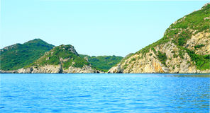 View on a bay and mountain chain on the island corfu in the mediterrannean sea. By daylight Royalty Free Stock Images