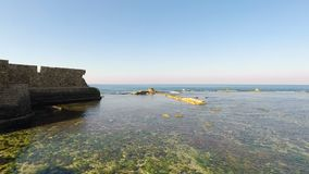 View of the bay and ruins in Akko or Acre, Israel, on a calm, sunny day. stock video