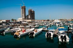 View of the bay with tall buildings and boats Royalty Free Stock Image