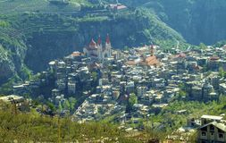 The beautiful mountain town of Bcharre in Lebanon. A view of Bcharre, a town in Lebanon high in the mountains on the edge of the Qadisha Gorge. Religious royalty free stock image