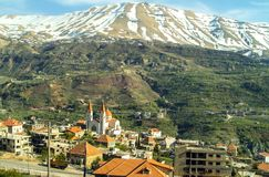 The beautiful mountain town of Bcharre in Lebanon. A view of Bcharre, a town in Lebanon high in the mountains on the edge of the Qadisha Gorge. Religious stock images