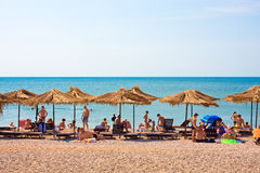 View of the beach. KOKTEBEL, UKRAINE - JULY 5: People swim and sunbathe at the city beach of Koktebel on July 5, 2012 in Koktebel, Ukraine. The beach is one of royalty free stock photo