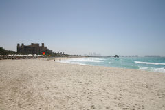 View of beach with Al Qasr resort. In background, Dubai Royalty Free Stock Photography