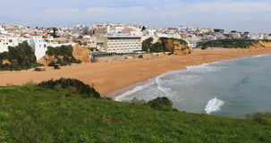 View of the beach at Albufeira, Portugal from clifftop stock video footage