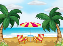A view of the beach with a beach umbrella and chairs Royalty Free Stock Photo