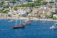 View of the beach of  Bodrum from the sea with the Gulet type sc Stock Photos