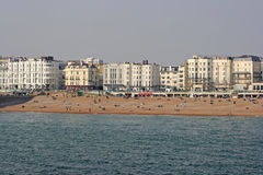 View of the beach at Brighton, UK. Visitors enjoying the beach in Brighton.The seafront is full of bars and restaurants and being less than an hour from London Stock Image