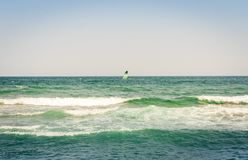 View from the beach of Catania, Sicily, Italy, Lido Cled with the green windsurf board in the sea.  royalty free stock photo