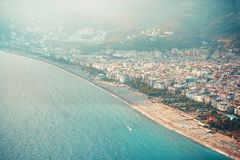View of the beach Cleopatra. Alanya, Turkey.Wonderful country.At home from a height. Roofs of buildings.View of the city.Observati. On deck.Mountains of Alanya royalty free stock images