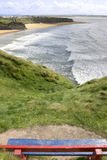 View of beach and cliffs in Ballybunion from bench Stock Image
