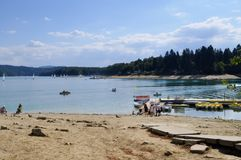 View of beach and coastline and boats waiting for people stock photos