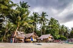 View of beach,cottages and palm trees- Philippines Stock Image