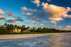 View of the beach from the fishing pier in Naples, Florida. Stock Photos