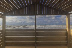 View from the beach gazebo to the stormy sea stock images