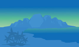 View beach and highlands with blue background. Of silhouette Stock Photography