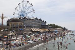 View of the beach and the hotel complex `Priboy` in the resort village of Lazarevskoe, Sochi. Lazarevskoe, Sochi, Krasnodar region, Russia - June 29, 2014: View Stock Images