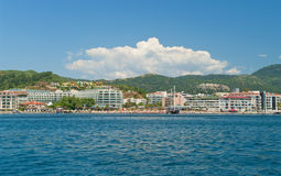 View of beach with hotels and sunbeds from sea Stock Photos