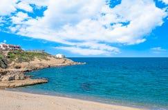 View of beach inside the city. Blue, balai, sea, water, nature, summer, landscape, coast, sardinia, island, vacation, sunny, scenic, coastline, sky, beautiful royalty free stock photo