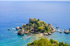 View of beach and island Isola Bella in Sicily stock photo
