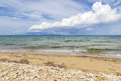 View from the beach of Katragaki beach Zakynthos on dark clouds over the Greek mainland royalty free stock photos