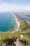 View of beach, lake and clear sea from Mount Circeo Stock Images