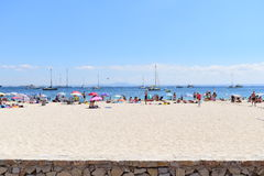 View on the beach in mallorca islands. Photo of beach in malorca island with people, yacht, white sand and view on the sea Stock Image