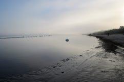 A view of a beach on a misty day in Autumn, Latvia, J. Urmala royalty free stock photos