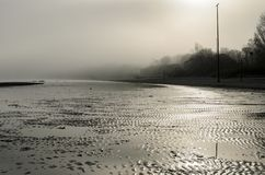 A view of a beach on a misty day in Autumn, Latvia. Jurmala stock photography