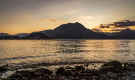 View from beach of mountains andlake royalty free stock image