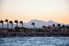 View of the beach and mountains in the distance. Hurghada, Egypt. Windy evening on the coast Royalty Free Stock Image
