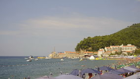 View on beach and old town, Petrovac, Montenegro, timelapse stock footage