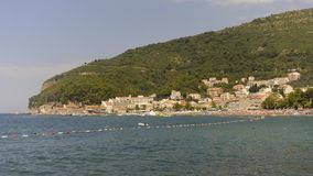 View on beach and old town, Petrovac, Montenegro, timelapse stock video footage
