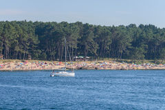 View of the beach with people from the sea Stock Photography