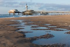 View from the beach at the Pier of Scheveningen, The Netherlands Royalty Free Stock Photography