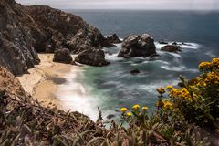 A view of a beach in the Point Reyes National Park, California, gorse frames the view to the beach. Long exposure to smooth out the water stock images
