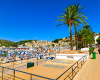 View of the beach of Port de Soller with people lying on sand, Soller, Balearic islands, Spain. Stock Photos