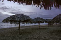 Empty Beach Shelters Early in the Morning stock photos