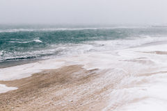 View of the beach and sea during blizzards and snowfall, minimal Royalty Free Stock Photography