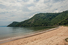 View of beach, sea and forest on cloudy day in Paraty Mirim. royalty free stock photography