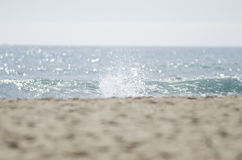 View of beach and sea out of focus and a splash of the sea on fo. Cus as background stock photo