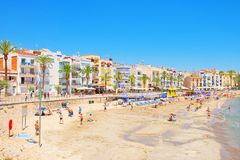 View of the beach and the sea shore of a small resort town Sitge. Sitges, Spain - June 14, 2017 : View of the beach and the sea shore of a small resort town Royalty Free Stock Image