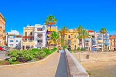 View of the beach and the sea shore of a small resort town Sitge. Sitges, Spain - June 14, 2017 : View of the beach and the sea shore of a small resort town Stock Image