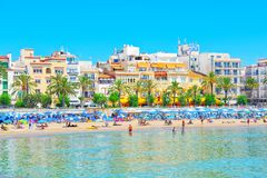View of the beach and the sea shore of a small resort town Sitge. Sitges, Spain - June 14, 2017 : View of the beach and the sea shore of a small resort town Stock Photo