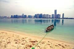 City with boat. A view from the beach side of Dubai city Stock Photo