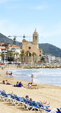 View of the beach of Sitges with church in the background Stock Image