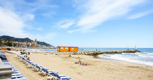 View of the beach of Sitges with church in the background Royalty Free Stock Photos